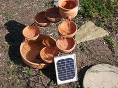 33 Soothing DIY Water Features   DIY Cozy Home/various bowls solar fountain