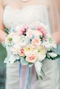Classic Rose & Tweedia Bouquet with Berries. A colorful bouquet comprised of roses, dusty miller, tweedia, and berries.
