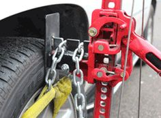 Safe Jack Hi-Lift Jack Secure Lifter (PART NO. 14020) in use with Chain (PART NO. 14025) and Sling (PART NO. 14026)