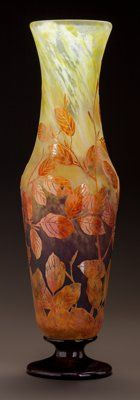 DAUM MOTTLED OVERLAY GLASS FOLIATE VASE Circa 1900. Cameo DAUM, NANCY, with the cross of Lorraine Ht