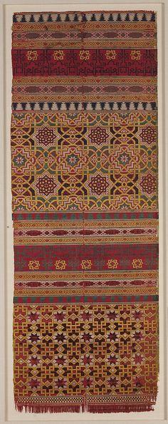 Date:      14th century  Geography:      Spain  Medium:      Silk; lampas  Dimensions:      Textile: L. 40 3/16 in. (102 cm) W. 14 5/16 in. (36.3 cm) Mount: L. 45 1/4 in. (114.9 cm) W. 19 3/4 in. (50.2 cm) D. 1 in. (2.5 cm)