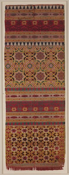 Date:      14th century  Geography:      Spain  Medium:      Silk; lampas  Dimensions:      Textile: L. 40 3/16 in. (102 cm) W. 14 5/16 in. (36.3 cm) Mount: L. 45 1/4 in. (114.9 cm) W. 19 3/4 in. (50.2 cm) D. 1 in. (2.5 cm)