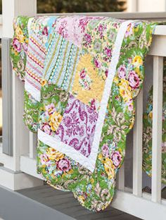 Easy Breezy Beautiful by Jenny Doan. This quilt from Quilting Quickly Fall 2013 features square quilt blocks and a scalloped quilt border.