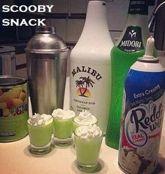 Scooby Snack 1/2 oz - Malibu Coconut Rum 1/2 oz - Midori Melon Liqueur Splash of Pineapple Juice Splash of Whipped Cream 1. Pour rum, melon liqueur and pineapple juice into a stainless steel shaker over ice. 2. Add whipped cream, and shake; until well mixed and sufficiently chilled. 3. Strain into shot glass. 4. Add a little whipped cream on top.