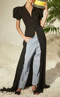 This **Rosie Assoulin** dress features a notch collar, puff short sleeves, a cinched waist, and a maxi length.