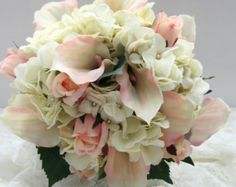 This Bouquet is sold but can be made upon request in your wedding colors.......PLEASE contact me if you are interested in a bouquet. Please contact me before ordering this bouquet thanks so much.    This 10 bouquet I designed in shades of Ivory Champagne and Dusty Rose made with a combination of fabrics including satin, chiffon, lace and tulle. It has beautiful rhinestone and pearl accents throughout. The handle is gorgeous with its Ivory Venice Lace Appliques and Rhinestone embellishment…