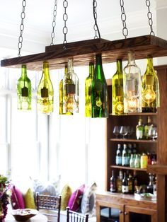 Upcycled Lamps and Lighting Ideas: Save wine bottles from special occasions and use them to make a personalized chandelier. Before you begin the project, mark the label on each bottle with the date and event. This way you can look up at your new light fixture and reminisce about the time each bottle was enjoyed.  From DIYnetwork.com