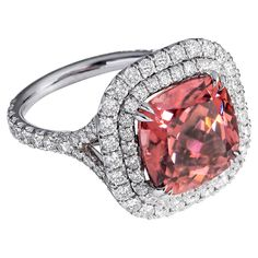 Rare cinnamon pink zircon Diamond Gold ring. A rare cinnamon pink zircon sits at the center of this magnificent ring, worthy of sitting beside the important and expertly-crafted jewels held in royal vaults. The impressive almost 9-carat cushion-cut stone is given a setting that emphasizes its unique beauty. It is embellished with over 1.5 carats of diamonds, including a luminescent double halo of diamonds around the center stone and a split shank band. Crafted in 18k white gold.