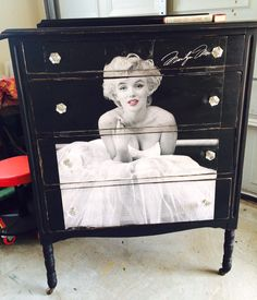 Dresser painted in black and decoupage poster of Marilyn Monroe