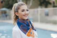 """Take a flight with this lightweight silk chiffon square scarf with bright orange hotair balloons. - 100 % silk chiffon - 33"""" x 33"""" - Hand rolled hem - Designed in the US, developed and hand sewn in It"""
