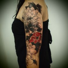 I like the color choice here (assuming the piece is done) all black and grey and this one red flower