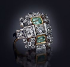 two emerald cut green beryls and old European cut diamonds,