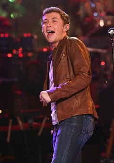 Love to watch Scotty McCreery sing an Elvis song because he really gives it all in his performance. He kicks his leg and shakes a bit just like his music idol. This performance took place at The Grove in L.A.