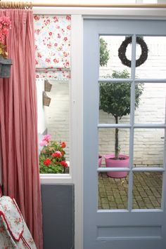 love the curtains and the roman shade with pom-poms