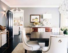 Color scheme: light gray walls, white trim, dark gray door
