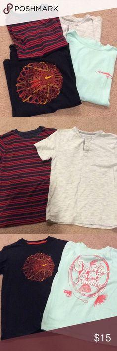 Bundle of boys shirts 4 boys tees, size Large Black tee= Nike, 100% cotton Aqua tee= J. Khaki, 60%cotton, 40% poly Blue &red striped tee= Cat and Jack, 60% cotton, 40% poly Gray tee= Cherokee, 100% cotton Shirts & Tops Tees - Short Sleeve