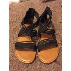 Black strappy sandals Worn 1-2 times. Great condition, just a little big for me! Shoes Sandals