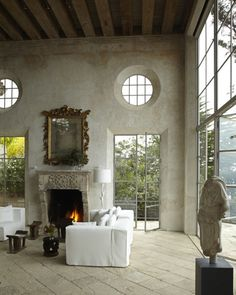 """Loving the unfinished plaster walls, exposed beams and stone paver flooring. Raw glamour!"" Ditto"