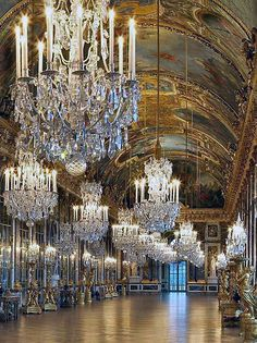 Chandeliers at Palace of Versailles's Hall of Mirrors.   In the 1670s Louis XIV built the Grand Apartments of the King and Queen, whose most emblematic achievement is the Hall of Mirrors designed by Mansart, where the king put on his most ostentatious display of royal power in order to impress visitors. The Chapel and Opera were built in the next century under Louis XV.