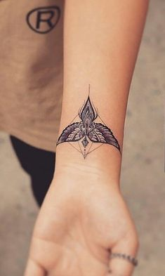 Cool design for angel tattoo, just change that jewel looking part into the head/halo