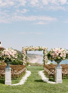 Grand, stately arrangements at the beginning of the aisle; I'd like  some more spilling vines/softness around the base
