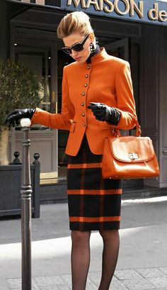 Shop this look for $372:  http://lookastic.com/women/looks/sunglasses-and-coat-and-gloves-and-satchel-bag-and-pencil-skirt-and-tights-and-turtleneck/3967  — Black Sunglasses  — Orange Coat  — Black Leather Gloves  — Orange Leather Satchel Bag  — Black Plaid Wool Pencil Skirt  — Black Tights  — Black Turtleneck