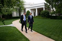 President Barack Obama and Education Secretary Arne Duncan walk from the Oval Office to the motorcade for the trip to Washington-Lee High School in Arlington, Virginia