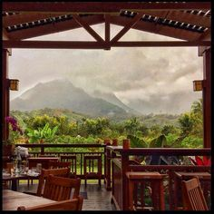View from Ama restaurant in Hanalei, Kauai. We sat with Mai-Tais and watched rainshowers bring waterfalls down the side of the mountains.…