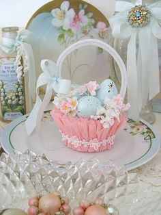 shabby chic Easter-inspiration-basket looks like a pipe cleaner, a dyed coffee filter or tissue paper, ribbon, and trim wrapped around the basket-very cute