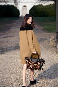 Longchamp do leopard print worn beautifully by Alexa Chung. She looks over her shoulder in that luxury camel coat.