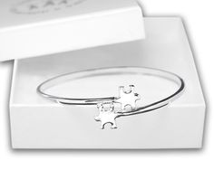 Elegant Autism Awareness Puzzle Bangle Bracelet with Gift Box  http://thehouseofawareness.com/collections/autismawarenessbracelets/products/elegant-autism-awareness-puzzle-bangle-bracelet-with-gift-box
