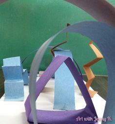STEM activity for kids using scrap paper to design and build an imaginary playground.
