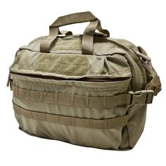 Mission Go Bag (Old Version)   Key Features: • Classic go bag for all occasions • Shoulder strap included • 2 rows of MOLLE across front • Compression straps on both sides • Front Velcro for morale patch • 2 compartments • 4 large interior pockets • Side flaps can tuck away inside for briefcase carry • Non Slip material on back • Material: 500D Cordura® Nylon • Dimensions: 4.5 in. x 11.5 in. x 10.25 in.