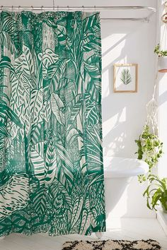Saskia Pomeroy Plants Shower Curtain | All white bathroom with botanical shower curtain and plants