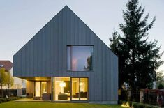 House as abstract volume with cut-outs... JEMS Architekci