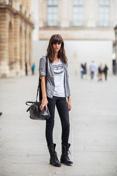 Casual Fall outfit: Graphic tee, black pants, and combat boots.