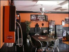 Harley Garage I Installed PVC Diamond Plate Floor Tile Painted Walls Black And Orange Decorated In Memorabilia Pay Phone Professional Poker