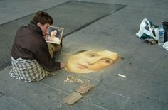 """Drawn by Francois Pelletier  with blended layers of colored chalk  on the streets of Paris, this painting is """"La Treille"""" by William-Adolphe Bouguereau."""