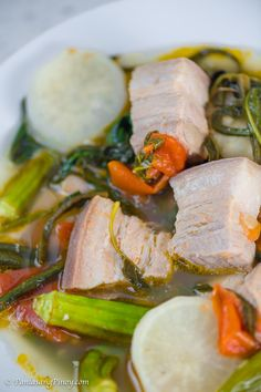 Sinigang na Baboy with Gabi is a popular Filipino soup dish. It is composed of pork and vegetables boiled in a clear sour broth. Sinigang Na Baboy Recipe, Pork Sinigang, Pork Recipes, Asian Recipes, Cooking Recipes, Healthy Recipes, Guam Recipes, Easy Filipino Recipes, Vegetarian Recipes