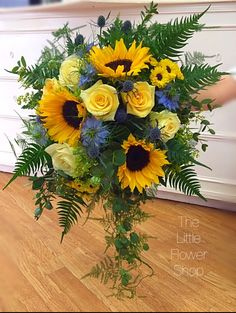 Sunflower Bridal bouquet Sunflower, Rose, Cornflower, Thistle #weddingflowers #florist #wirral #sunflowerbouquet #yellow #blue www.flowershopwirral.co.uk