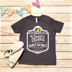 This Disney Shirts Snuggly Duckling Shirt Snuggly Duckling Brewing Company Tangled Shirt Disneyland Shirt Disney World Shirt Disney Cruise Shirt is just one of the custom, handmade pieces you'll find in our graphic tees shops. Disneyland Shirts, Disney World Shirts, Disney Shirts For Family, Disney Tees, Disney Apparel, Disneyland Outfits, Disney Diy, Disney Crafts, Disney Icons