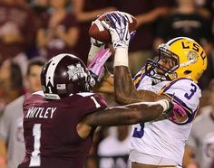 Louisiana State wide receiver Odell Beckham Jr. (3) catches a pass over Mississippi State defensive back Nickoe Whitley (1) in the second ha...