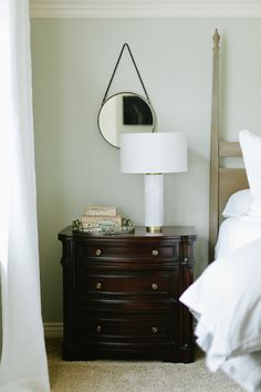 Straight and narrow. Featuring a marble-finished base and white linen shade, the Pillar Table Lamp looks right at home in a mid-century room. Its size and scale are perfect for a nightstand or entryway console.