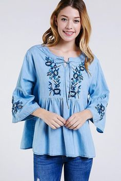 Let your inner bohemian shine with this top that features intricate embroidery and a tie neckline. Breathable cotton denim fabric will keep you cool when temperatures skyrocket. Kids Tops, Swing Top, Denim Fabric, Bell Sleeves, Bohemian, Tunic Tops, Blouse, Cotton, Women