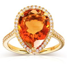 The gorgeous Pear-Shape Orange Citrine and Diamond Engagement Ring by Kobelli Jewelry comes in 10K yellow-gold design and lots of deliciousness. This touching engagement ring includes a pear-shape orange citrine gem and a sparkling row of 64 round-cut diamonds decorating the lustrous band. The entire piece is skillfully designed in prong setting, featuring a total of 65 precious stones.