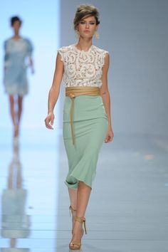 This is a beautiful dress from Ermanno Scervino.  It manages to bring a modern feel to an antique style.