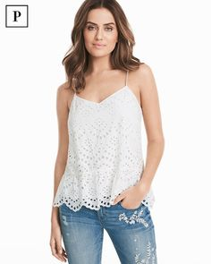 """Just in: a classic white cami, now reinvented with eyelet detailing, airy femininity and scalloped flounce hem. We love the much-needed dose of charm it adds to jeans.  Petite eyelet white cotton cami Tie-back detail Lined Regular: Approx. 25"""" from shoulder Petite: Approx. 23 5/8"""" from shoulder 100% cotton. Machine wash cold. Imported"""