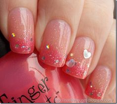Cute Valentine's nails...pink gradient nails with heart shaped crystals...
