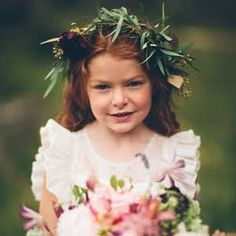 The flower girl wore a feminine ivory dress and accessorized with an olive branch floral crown.