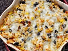 Chicken, black bean, corn, cheese and rice makes up this yummy, easy to make, healthy dish! Would be a good tortilla filler for a crowd!